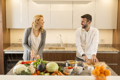 Loving couple in the modern kitchen Stock Images