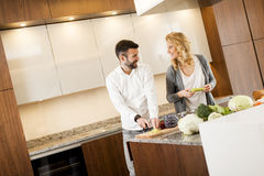 Loving couple in the modern kitchen Stock Photos