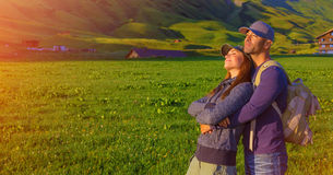 Loving couple in the mountains. Loving couple enjoying sunset in the mountains, Alps, Austrian mountain, summer adventure, active family, romantic travel in Stock Images