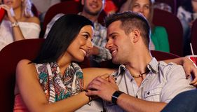 Loving couple in movie theater Royalty Free Stock Photography