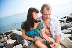 Loving couple near of blue sea Stock Image