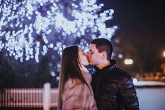 Couple and The Christmas tree Stock Images
