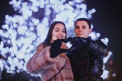Couple and The Christmas tree Stock Photos