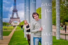 Loving couple near the Eiffel Tower in Paris Royalty Free Stock Photos