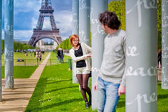 Loving couple near the Eiffel Tower in Paris. Lovers in Paris with the Eiffel Tower in the Background Stock Photo