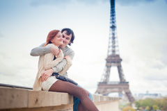 Loving couple near the Eiffel Tower in Paris. Lovers hugging in Paris with the Eiffel Tower in the Background Stock Photos