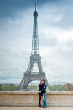 Loving couple near the Eiffel Tower in Paris. Lovers hugging in Paris with the Eiffel Tower in the Background Royalty Free Stock Image