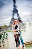 Loving couple near the Eiffel Tower in Paris Stock Image