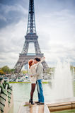 Loving couple near the Eiffel Tower in Paris Royalty Free Stock Photography