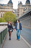 Loving couple near the Eiffel Tower in Paris. Lovers walking and smiling in Paris Stock Photography