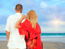 Loving couple near the ocean Stock Images
