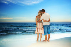 Loving couple near the ocean stock photography