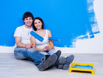 Loving couple near the painted wall Stock Photos