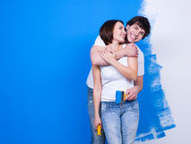 Loving couple near the painted wall Royalty Free Stock Image