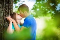 Loving couple near a tree Royalty Free Stock Photography