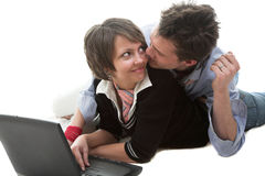 Loving couple and notebook. Loving young couple and notebook isolated on white Royalty Free Stock Photos