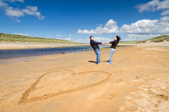 Free Loving Couple On The Beach Stock Photography - 24781342