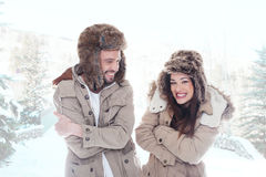 Loving couple outdoors in the snow Stock Photography