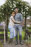 Loving Couple Outside Country House Stock Photo