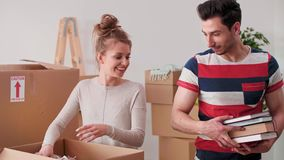 Loving couple packing stuff to cartons. During moving stock video