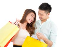 Loving couple with paper bags Stock Images