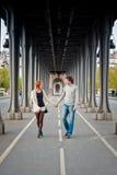 Loving couple in Paris. Lovers walking on the bridge in Paris near Eiffel Tower Stock Image
