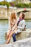 Loving couple in Paris near Notre-Dame cathedral Royalty Free Stock Photos
