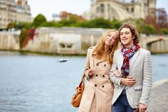 Loving couple in Paris near Notre-Dame cathedral Royalty Free Stock Image