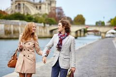 Loving couple in Paris near Notre-Dame cathedral Stock Photos
