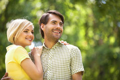 Loving couple in park. Royalty Free Stock Images