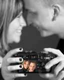 Loving couple photographing Royalty Free Stock Image