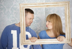 Loving couple in picture frame. Stock Photos