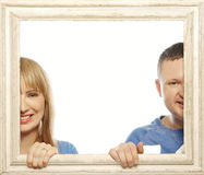 Loving couple in picture frame. Stock Image