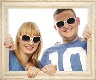 Loving couple in picture frame. Royalty Free Stock Images