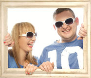 Loving couple in picture frame. Stock Images