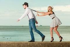 Loving couple playing on date by sea coast Stock Photo