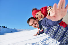 Loving couple playing together in snow outdoor. Stock Photos