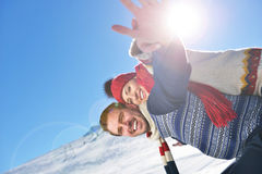 Loving couple playing together in snow outdoor. Royalty Free Stock Images