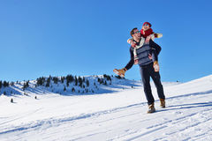 Loving couple playing together in snow outdoor. Stock Photography