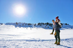 Loving couple playing together in snow outdoor. Royalty Free Stock Image