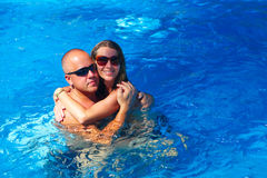 Loving couple in pool Stock Photo