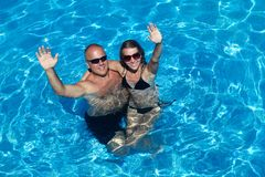 Loving couple in pool Royalty Free Stock Image