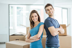 Loving couple posing in their new house Stock Photos