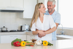 Loving couple preparing a healthy dinner together Stock Image