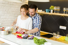 Loving couple preparing healthy food Stock Photography