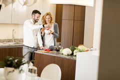 Loving couple prepating vegetarian food in the modern kitchen Royalty Free Stock Photo