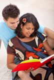 Loving couple reading Royalty Free Stock Images
