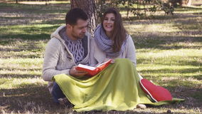 Loving couple reading a book stock footage