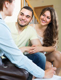 Loving couple with real estate agent Royalty Free Stock Photo