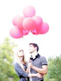 Loving couple with red balloons Royalty Free Stock Photos